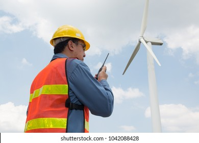 Telecommunication or Construction Equipment Concept, Male Architect or Engineer use Two way Radio to Communicate with Headquarter or Site working in Wind Turbine Power Generator Field
