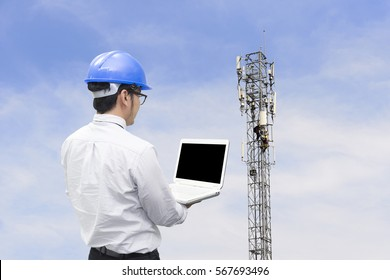The telecommunication engineer while checking the  signal   with the technician who change spare part on the telecommunication tower