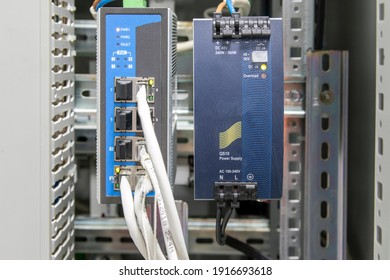 Telecommunication equipment close up. Automatic control systems. Close-up of automatic systems controller. Wires are connected to the network equipment. Fiber optic equipment concept.