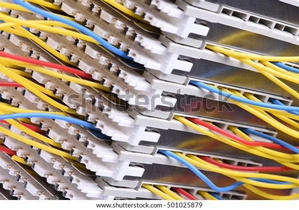 Telecommunication main distribution frame with colorful cables, close up