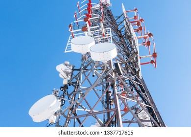 Telecommunication mast TV antennas wireless technology with blue sky in the morning