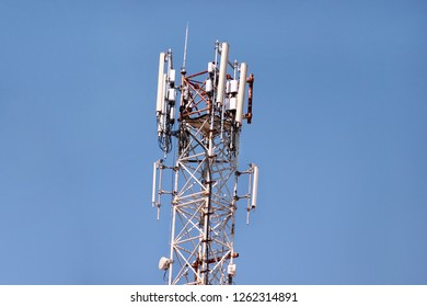 Telecommunication network repeaters, base transceiver station. Tower wireless communication antenna transmitter and repeater. Telecommunication tower with antennas. Cell phone telecommunication tower.