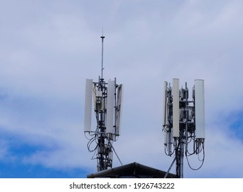 Telecommunication pole of 3G, 4G and 5G cellular. Small Base Station or Base Transceiver Station. Wireless Communication Antenna Transmitter against clouds sky background.