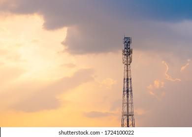 Telecommunication pole on sunset background