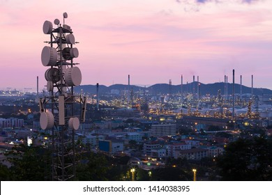 Telecommunication tower with 5G cellular network antenna on industrial zone background