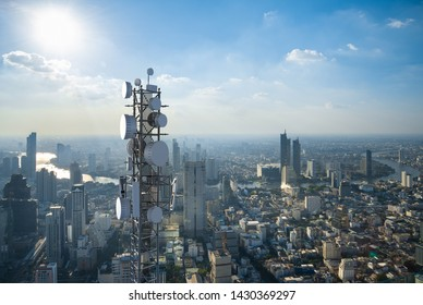 Telecommunication tower with 5G cellular network antenna on city background - Shutterstock ID 1430369297