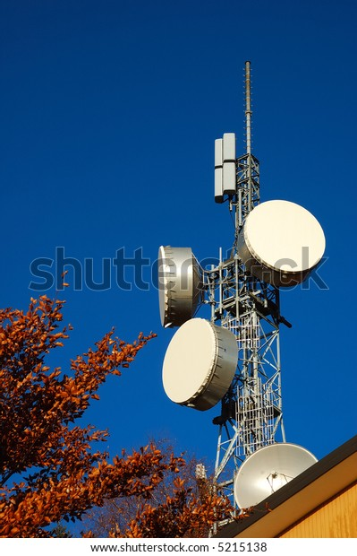 Telecommunication tower against blue sky