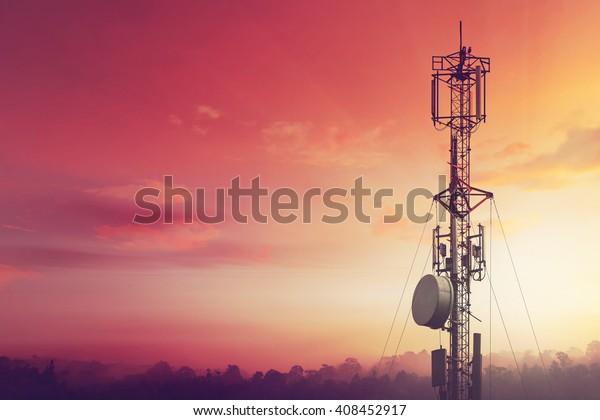 Telecommunication tower Antenna at sunset.