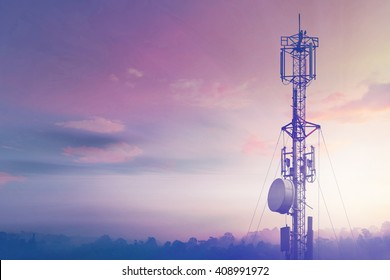 Telecommunication tower Antenna at sunset sky.