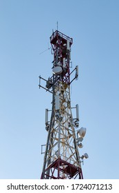 Telecommunication tower. Blue sky in the background