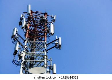 Telecommunication tower with blue sky in the background
