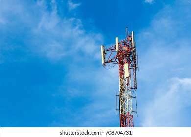 Telecommunication Tower. Cell Phone Signal Tower on blue sky background