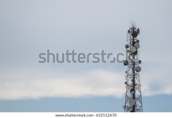 Telecommunication tower for connection with telephone and blue sky.