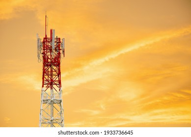 Telecommunication Tower With Gold Sky Background.