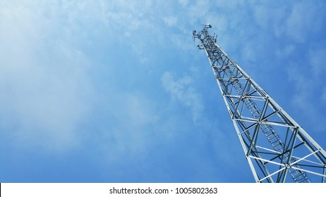 telecommunication tower on blue sky background. mobile site base.