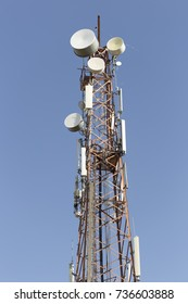Telecommunication tower on blue sky clouds background,Tower poles and wireless telephone antennas