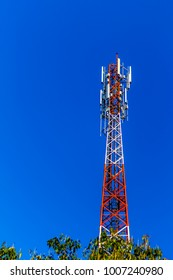 telecommunication tower on open blue sky.