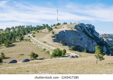 Telecommunication tower on top of a mountain. Russia, Republic of Crimea. 06.13.2018. TV and radio tower on top of Ai-Petri mountain