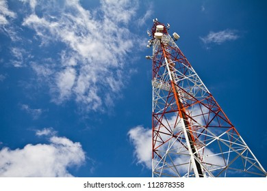 Telecommunication tower and sky blue .