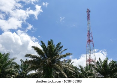The telecommunication tower in sky with clouds background