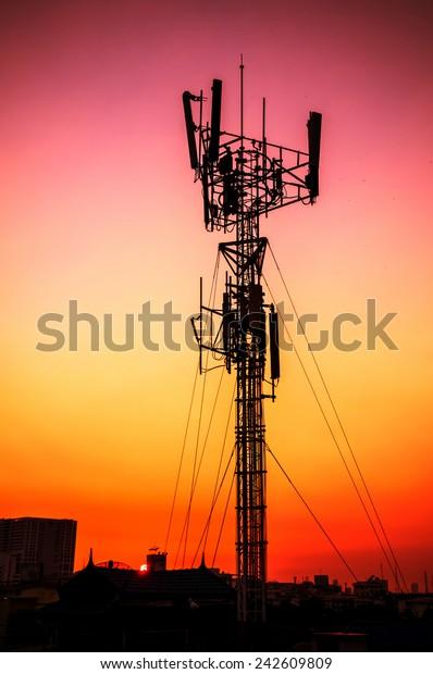 telecommunication tower - sunset silhouette broadcasting steel telephone technology tall radar communication background