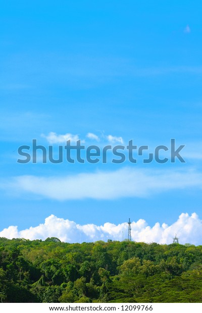 Telecommunication towers on the hilltop and blue skies