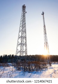 telecommunication towers at sunset. ladders, support towers and metal structures cell towers. vertical