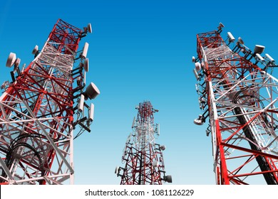 Telecommunication towers with telecom satellite dish network technology for mobile phone connect social communicate. on blue sky