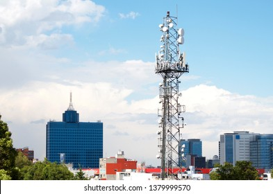 Telecommunications antenna with World Trade Center building at the background, Mexico City, 2016.