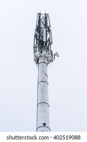 Telecommunications tower isolated on sky