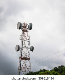 Telecommunications tower. Mobile phone base station and cloudy rain