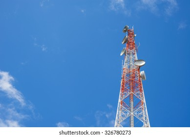 Telecommunications tower on tiny blue sky and cloud background