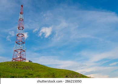 Telecommunications tower over blue sky background.