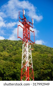 Telecommunications tower over blue sky background