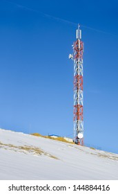 Telecommunications tower, radio or mobile phone base station on snow hill
