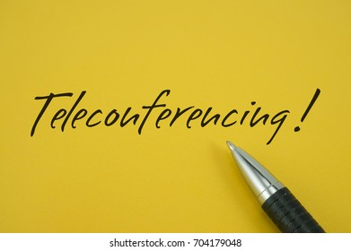 Teleconferencing! note with pen on yellow background