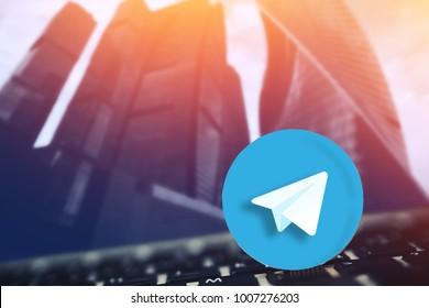 Telegram. Gold Bitcoin ICO coin Gram on background.