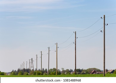 telegraph pole on blue sky horizon at springtime sunny day in south germany