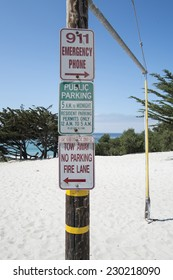 Telegraph pole signs on beach Carmel USA