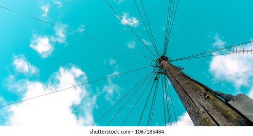 Telegraph pole with turquoise sky