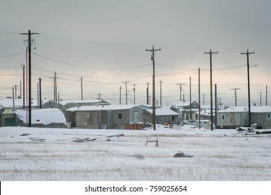 Telegraph wires above the homes at the eastern end of Kaktovik, Alaska