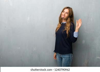 Telemarketer woman saluting with hand with happy expression