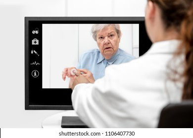 Telemedicine and elderly care with a senior woman and a doctor in front of a monitor, medical consultation