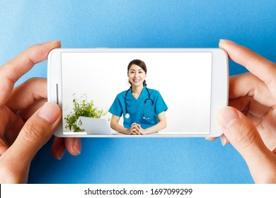 Telemedicine of a female doctor reflected on a smartphone