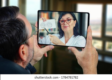 Telemedicine general practitioner explains to a mature man the importance of determining field of view (FOV) for him