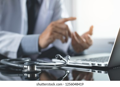 Telemedicine, Medical online, e health concept. Doctor video chat with patient via laptop computer, mobile health application. Doctor video conferencing, cropped image.
