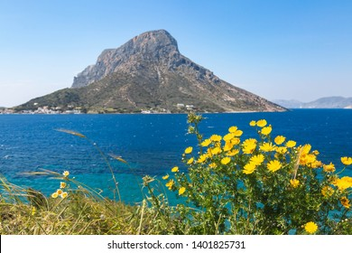 Telendos island, with flovers in front. Spring view on Kalumnos island. GRECE