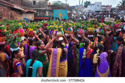 TELENGANA,INDIA-JULY 31: Indian crowd celebrates Bonalu festival at Telengana,India on July 31,2016. Bonalu is a yearly festival in Telengana to worship the Goddess of power with flower pots