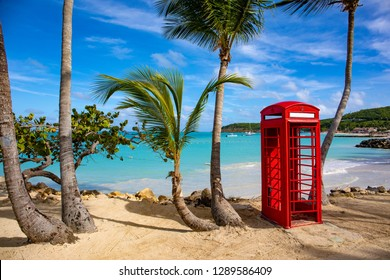 Telephone booth on a beautiful beach in Dickenson Bay on Antigua in the Caribbean.