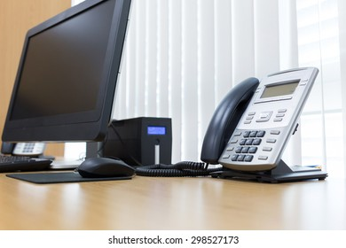 telephone and computer on table work of room service office